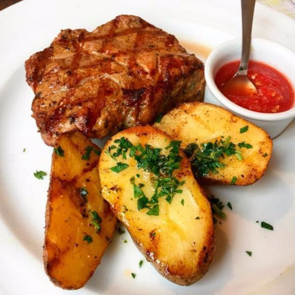 Фото Стейк із ошийка з печеною картоплею та аджикою в Very Well Cafe